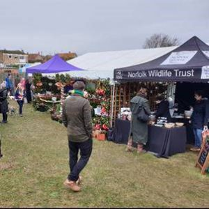 Norfolk Wildlife Trust chatting with visitors at Deepdale Christmas Market 2018