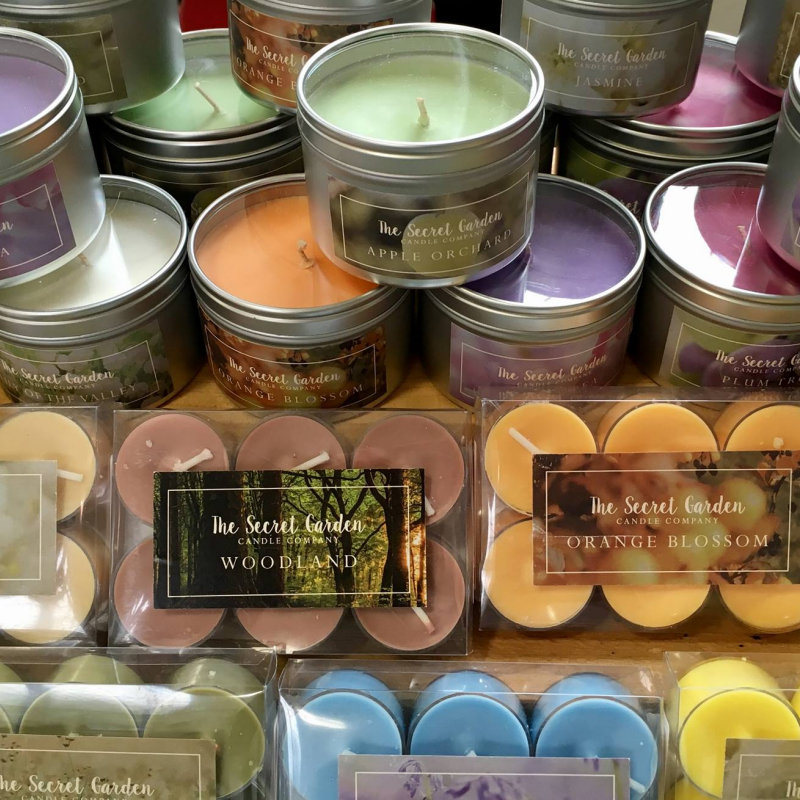The Secret Garden Candle Company - Hand Made Eco Soy Wax candles in contemporary tins and tea lights in various fragrances and colours.